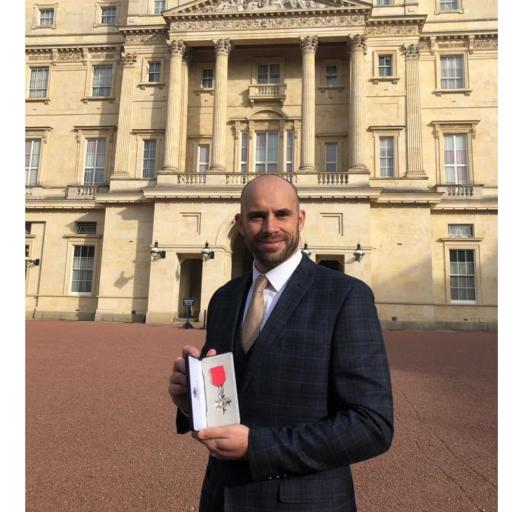 Kyle collects his MBE